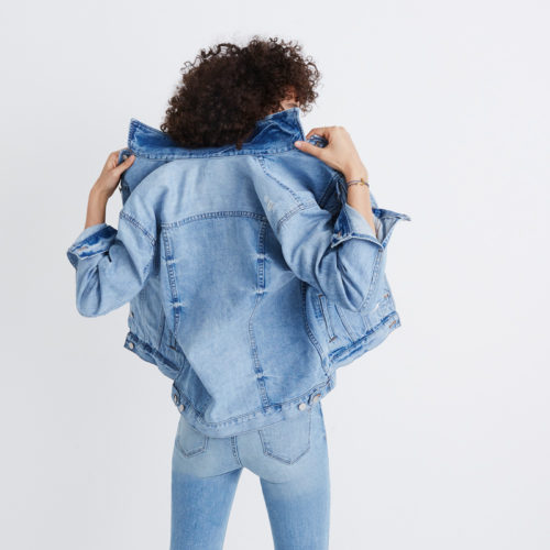 Image of a female model wearing a Madewell denim jacket and Madewell denim jeans for a blog post about the new store opening in Las Vegas.