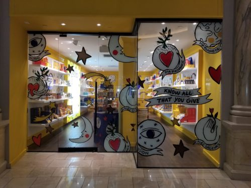 Photo of the decorated storefront of the L'OCCITANE Pop-Up Shop in Las Vegas.