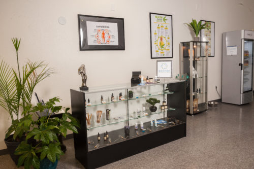 Photo image of the interior of Boomer Natural Wellness located in Las Vegas. The interior decoration features a glass case filled with wellness products.