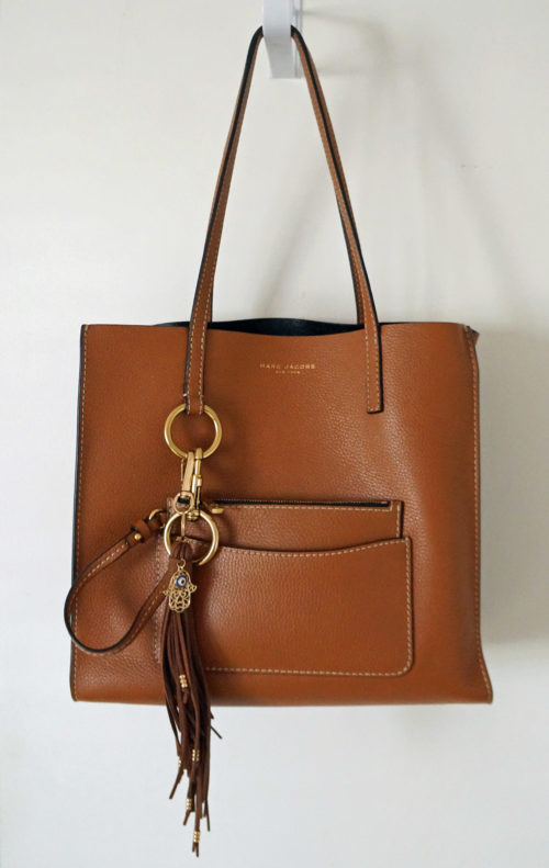 A photograph of a brown Marc Jacobs tote bag used in a blog post about how to keep tote bags organized.