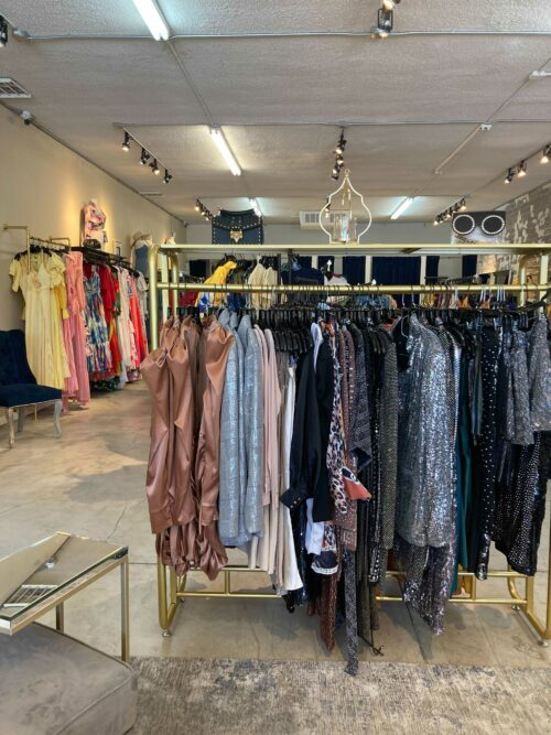 This is an interior photograph of Sabrak Boutique Las Vegas that shows racks of fashion clothing.