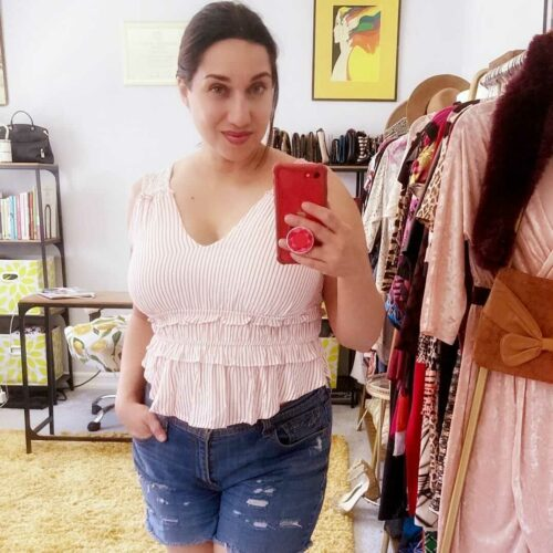 This is a mirror selfie photo of blogger, Laura Coronado, wearing a V-neck halter with ruffles, purchased from Sabrak Boutique Las Vegas.