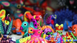 This is a very bright and colorful close-up photo of Mexican-made animal figurine toys.