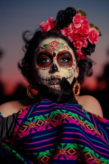This is a portrait photo of a woman wearing beautiful sugar skull makeup, which is not Mexican cultural appropriation.